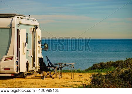 Camp Equipment Chairs And Table At Caravan On Coast In Spain. Wild Camping On Nature Beach. Holidays