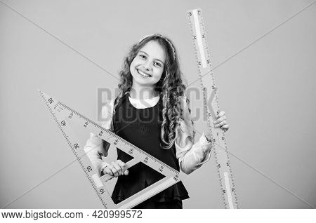 Small Girl Back To School. Pupil Girl With Big Rulers. Stem School Disciplines. School Student Learn