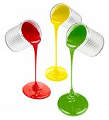 pouring colorful paints isolated on white poster