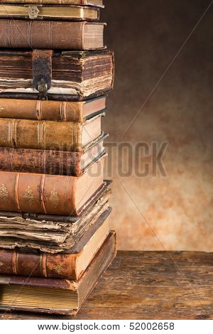 Stacked antique very old books leaving copy space