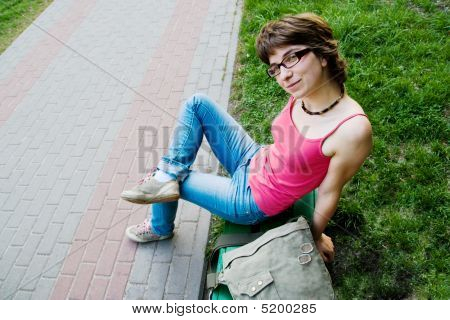 Girl On Park Bench