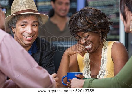 Woman Giggling With Friends