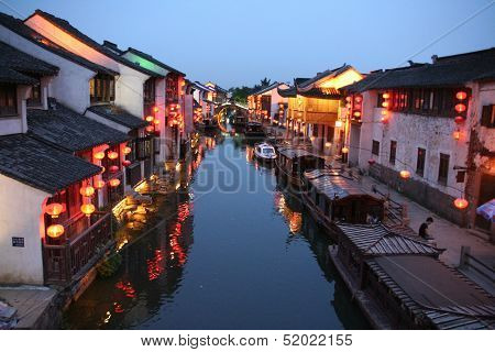 Night View Of A Canal In Old Suzhou, China