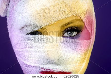 Dramatic Beauty Concept of Heavy Makeup Seeping Through Gauze