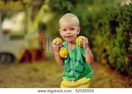 child with lemons