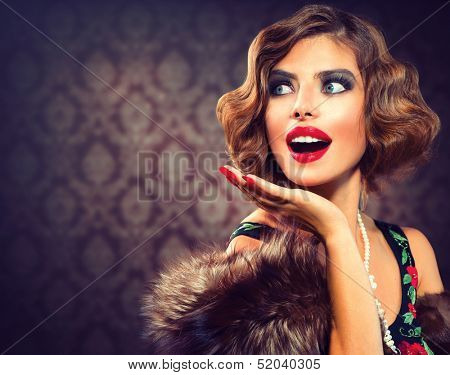 Retro Woman Portrait. Surprised Luxury Lady. Beautiful Woman. Vintage Styled Photo. Old Fashioned Makeup and Finger Wave Hairstyle. 20's or 30's style. Space for your text