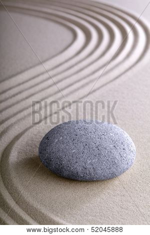Japanese meditation or zen garden simplicity , calmness and balance in a pattern of lines in sand and round stones