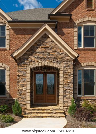 Luxury Model Home Exterior Stone Arch Front Entrance