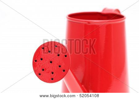 spout of red watering can