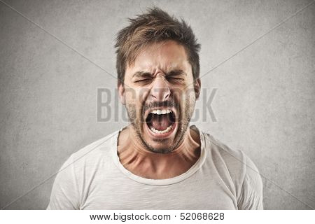 portrait of young man screaming