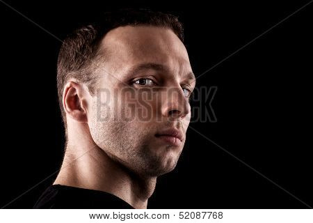 Haughty Young Caucasian Man's Portrait. Close-up Face Isolated On Black