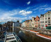 Travel Belgium medieval european city town background with canal. Koperlei street, Ghent, Belgium poster