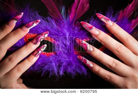 Human  Fingers With Long Fingernail Holding Venetian Mask
