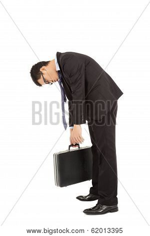 Exhausted Businessman Stoop And Holding Briefcase