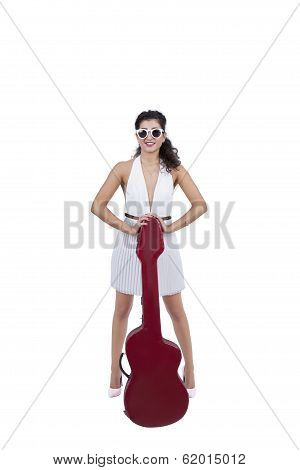 Attractive young woman posing with guitar