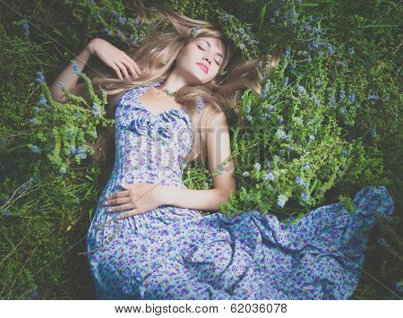 Beautiful Lady Lying Amond Flowers