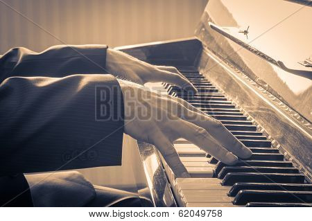 Man's Hands Playing The Piano.  Retro Style