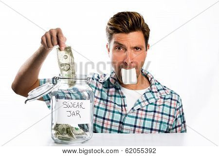 Man Paying A Swear Jar