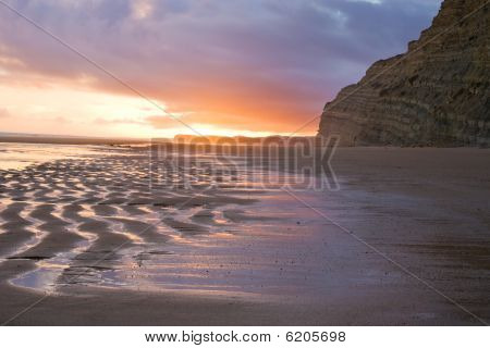 Sunset reflection on Sandy beach