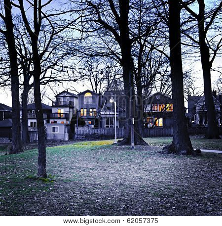 City park at dusk near residential houses