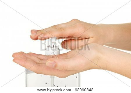 Female hands using hand sanitizer gel pump dispenser