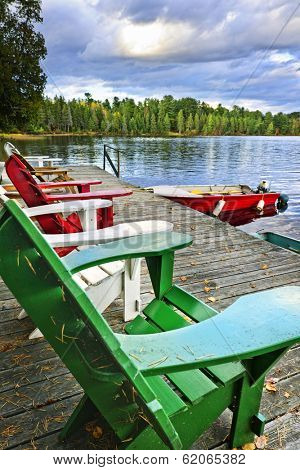 Deck chairs at dock on Lake of Two Rivers in Algonquin Park, Ontario, Canada