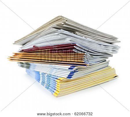 Printed paper publications stacked in a pile isolated on white