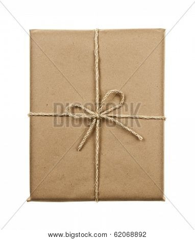 Gift package in brown paper wrapper tied with twine isolated on white background
