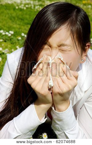 Portrait Of Sic Chinese Woman Sneezing Because Of Allergy And Flu