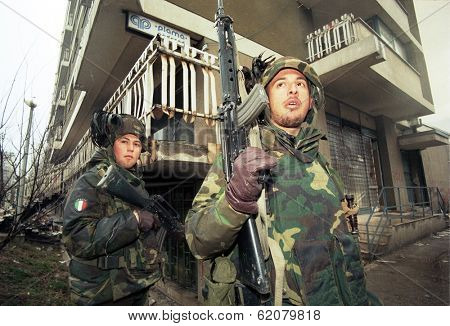 SARAJEVO, BOSNIA - MAR 18: Italian army troops, in Bosnia as part of the United Nations' UNPROFOR, patrol the streets of Sarajevo, Bosnia, on Monday, March 18, 1996.