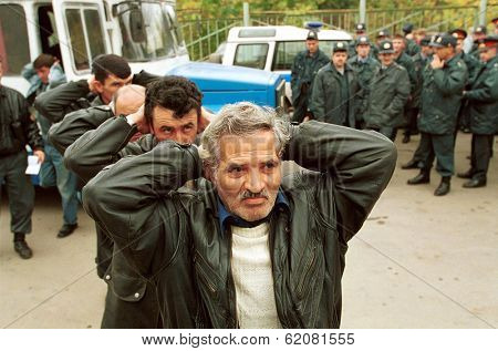 MOSCOW - SEPTEMBER 17: Men from Russia's Caucuses arrive at a police station after being arrested as part of a search for those behind deadly bombings which have claimed nearly 300 lives on September 17, 1999 in Moscow