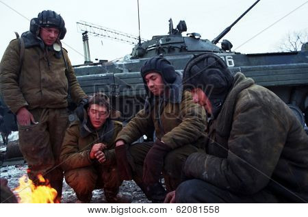 GUDERMES, CHECHNYA - JANUARY 16: Russian army armor troops try to keep warm, and catch a few minutes rest between fighting Chechen rebels in Gudermes, Chechnya, on Sunday, January 16, 2000.