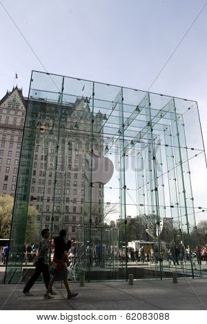NEW YORK - APR 4: Pedestrians walk in front of the cube of glass over the top of the Apple computer store on 5th Avenue in New York City, on April 4, 2010.