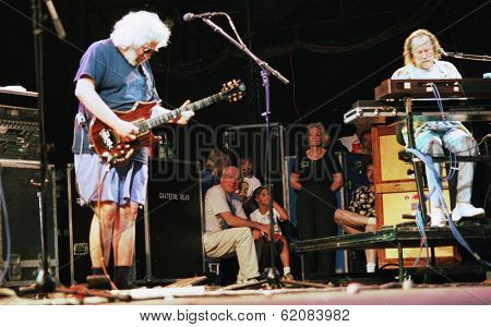 EAST RUTHERFORD, NEW JERSEY - AUGUST 3: The Grateful Dead in concert in East Rutherford, New Jersey, on Sunday, August 3, 1994. At left is Jerry Garcia, and Vince Welnick, on keyboards. At rear is US Senator  Patrick Leahy of Vermont.