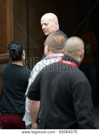 BUDAPEST - MAY 7: Actor Bruce Willis greets a production assistant on the first day of shooting of Die Hard 5: A Good Day To Die Hard in Budapest, Hungary, on Monday, May 7, 2012.