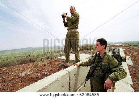 HAR KACHAL, ISRAEL - MARCH 28:  Israeli defense force (IDF) soldiers look over the border into the Syrian village of Kumeitra high into the Golan Heights on March 28, 2000 in Golan Heights Israel.