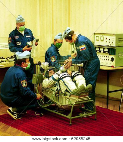 BAIKONUR COSMODROME - OCTOBER 31: US astronaut William Shepherd, commander of the first mission to the international space station gets suited up by Russian ground staff on October 31, 2000.