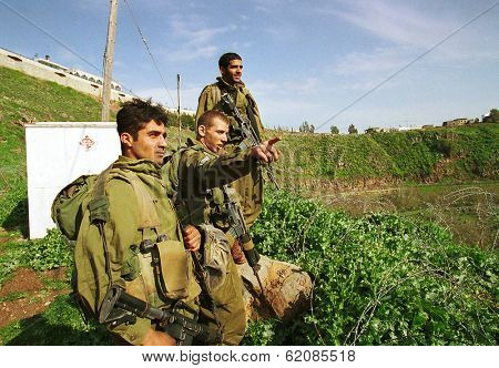 YUVAL, ISRAEL - MARCH 28: Israeli army soldiers (IDF) on a foot patrol along the Israeli border with Lebanon on March 28, 2000.