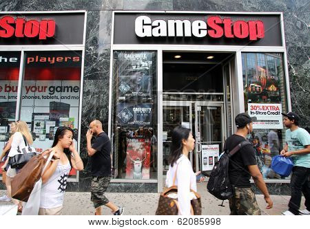 NEW YORK CITY - JULY 8: Shoppers walk past a GameStop retail store in New York City, New York, on Monday, July 8, 2013. GameStop Corp. is an American video game and entertainment software retailer.