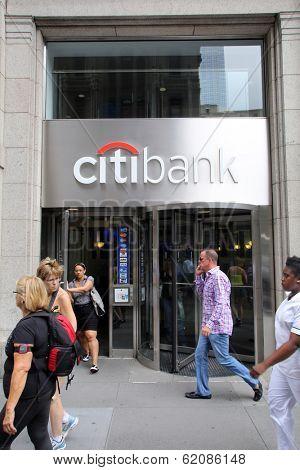 NEW YORK CITY - JULY 11: Pedestrians walk past a Citibank retail branch in lower Manhattan on Thursday, July 11, 2013.