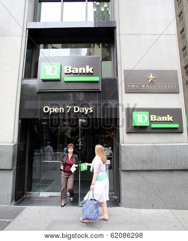 NEW YORK CITY - JULY 11: Pedestrians walk past a TD (Toronto Dominion) bank retail branch in lower Manhattan on Thursday, July 11, 2013.