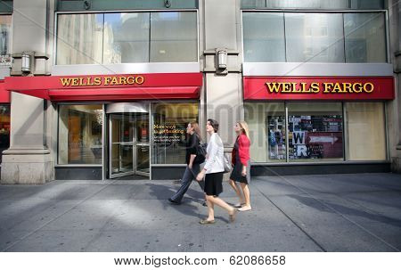 NEW YORK CITY - OCT 24 2013:  Pedestrians walk past a branch office of Wells Fargo & Company bank in Manhattan on Sunday, October 20, 2013.