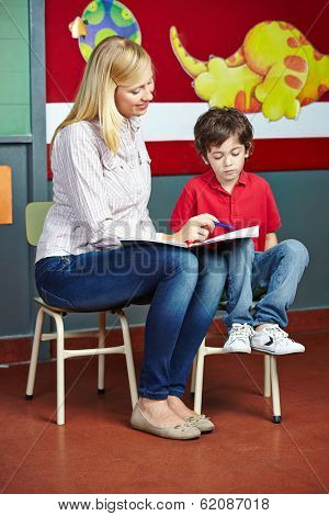 Elementary school student learning in private lessons with teacher