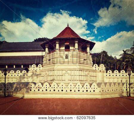 Vintage retro hipster style travel image of very important Buddhist shrine - Temple of the Tooth with grunge texture overlaid. Sri Lanka