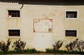 A wall on the exterior of the Friulian Farming Culture Museum (Museo della Civilta Contadina del Friuli Imperiale) in Aiello del Friuli Italy. This one shows a sundial known as the Meridiana ad Ore del Tramonto or Dawn Time Sundial poster