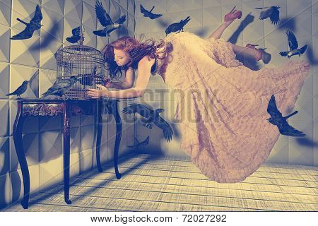 Floating Levitation shot of a Woman and Her Black Birds