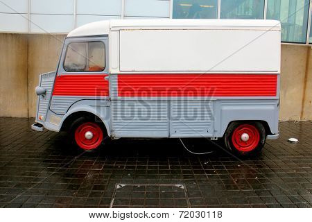 Old french delivery truck on a parking lot