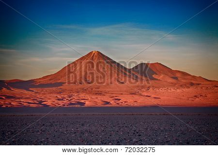 sunset over volcanoes Licancabur and Juriques, Atacama desert, Chile