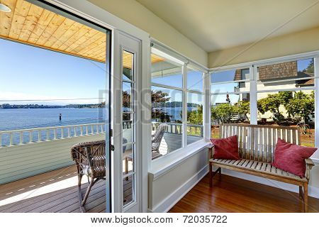 Sun Room And Walkout Deck. American Architecture. Real Estate With Water Front View.