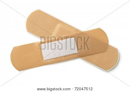 Two pieces of adhesive bandage isolated on white